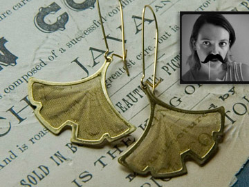 A mustachioed Larissa Loden and her gingko earrings