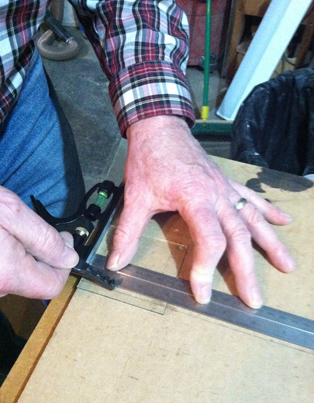 My dad acts as a hand model...er, cuts glass for a frame.