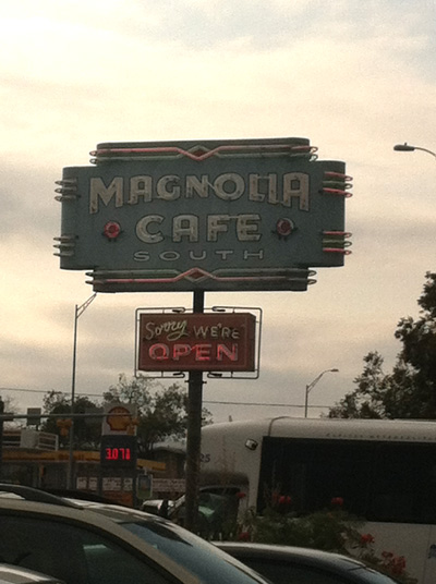 "The Magnolia Cafe is so worth the wait--there's always a long line. I love the ""Sorry, we're open"" sign, below. And the way the hostess sang Larissa's name over the loudspeaker to call us to our table."