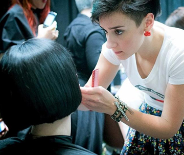 Stylist Kathryn Hornick of Root Salons and Wella Professionals works with a model.